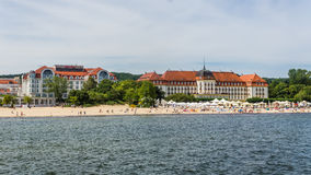 View of the beach in Sopot. A major health-spa and tourist resort on the Polish Baltic Sea coast with two luxury hotels, old style Sofitel Grand and modern Royalty Free Stock Photography