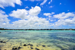 Seascape in Grand Baie, Mauritius. View of the beach at sunny day in Grand Baie, Mauritius. Mauritius is a major tourist destination, ranking 3rd in the region Royalty Free Stock Photography