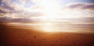 View of beach during sunny day. Scenic view of beach during sunny day Royalty Free Stock Image