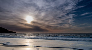 View of Beach at Sunset with Clouds Rolling In Royalty Free Stock Images