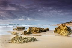 Beach of the Barrosa in Cadiz. View of the beach at sunset with storm clouds stock photo