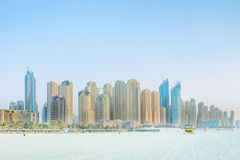 View from the beach to the skyscrapers in Dubai. Yellow sand in the foreground Stock Images
