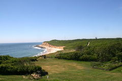 View of the beach from the top of the Montauk Light House. Oceanside cliff visible from the top of the Montauk Light House with a fenced-in garden in the Stock Images