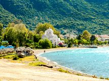 View of beach and white church in Kamena Vourla.Greece stock photo