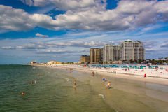 View of beachfront hotels and the beach from the fishing pier in Stock Photography