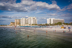 View of beachfront hotels and the beach from the fishing pier in Royalty Free Stock Photos