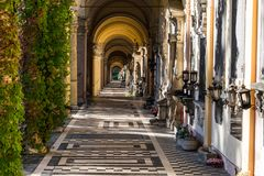 View of the beautiful arcades or colonnades in the Mirogoj Cemetery in Zagreb, Croatia. View of the beautiful arcades or colonnades with stone tombs and statues Royalty Free Stock Photography