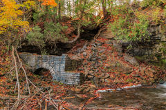 View of  beautiful autumn forest background, with a fragment of an old vintage brick mill fallen apart Stock Photos