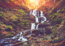 View of a beautiful autumn waterfall in mountains. Royalty Free Stock Photos