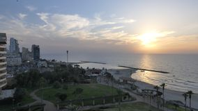View of a beautiful beach and some buildings in Netanya, Israel. Netanya, Israel during the sunset Stock Images