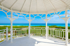 White wooden pavilion at Varadero beach in Cuba. View of the beautiful beach of Varadero in Cuba from the windows of a white seaside wooden pavilion Stock Photography