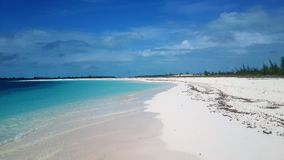 View of a beautiful beach with white sand in Cuba. View of a beautiful with white sand in Cuba. It´s a sunny day and there are no waves in the ocean Royalty Free Stock Images
