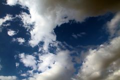 View of a beautiful blue sky with cumulus clouds stock image