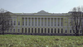 View of the beautiful building on a sunny day. With defocused green grass in front stock footage