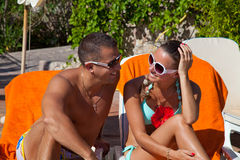 View of a beautiful couple sitting on deck chairs enjoying vacat Royalty Free Stock Photos