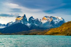 View of beautiful Cuernos del Paine Mountains and Lake Pehoe. In Torres del Paine National Park in the evening, Chile royalty free stock photo