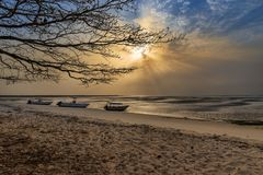 View of a beautiful deserted beach in the island of Orango at sunset, in Guinea Bissau. Orango is part of the Bijagos Archipelago; Concept for travel in Africa stock images