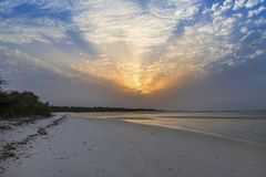 View of a beautiful deserted beach in the island of Orango at sunset, in Guinea Bissau. Orango is part of the Bijagos Archipelago; Concept for travel in Africa royalty free stock photo
