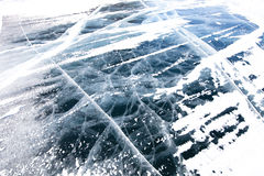 View of beautiful drawings on ice from cracks and bubbles of dee Royalty Free Stock Photos