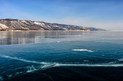 View of beautiful drawings on ice from cracks and bubbles of deep gas on surface of Baikal lake in winter, Russia stock image