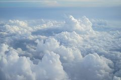 View of beautiful free form heaven cloud with shades of blue sky background from flying plane window. In morning sunrise Stock Photo
