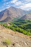 View on beautiful High Atlas Mountains landscape with lush green valley and rocky peaks, Morocco, North Africa Royalty Free Stock Photos