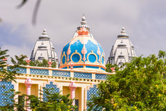 View of the beautiful Indian building, Puttaparthi, Andhra Pradesh, India. Copy space for text. View of the beautiful Indian building, Puttaparthi, Andhra Stock Photos