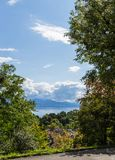 View on lake Leman. Swiss. View on beautiful lake Leman from park in down town with big cloud and wonderful sky. City of Lausanne, canton Vaud, Switzerland Royalty Free Stock Photo