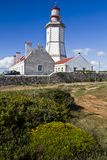 Lighthouse of Cape Espichel. View of the beautiful lighthouse of Cape Espichel, Sesimbra, Portugal Royalty Free Stock Photos