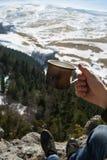 View of the beautiful mountain landscape through  legs of touris Royalty Free Stock Photo