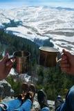 View of the beautiful mountain landscape through  legs of touris Stock Photos