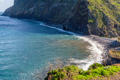 View of beautiful mountains and the ocean on the coast of the island of Madeira, Portugal Royalty Free Stock Photo