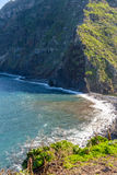 View of beautiful mountains and the ocean on the coast of the island of Madeira, Portugal Royalty Free Stock Image