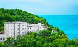 View at beautiful palace at the sea. View at a beautiful palace at the sea Royalty Free Stock Photo