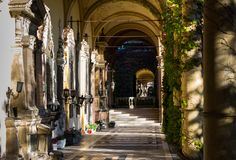View of the beautiful arcades or colonnades in the Mirogoj Cemetery in Zagreb, Croatia. View of the beautiful pillars or columns overgrown with ivy, arcades or Royalty Free Stock Images