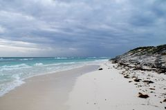View of a beautiful rocky beach with white sand in Cuba. View of a beautiful with white sand in Cuba. It´s a cloudy afternoon and there are some waves in the Stock Photos