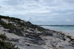 View of a beautiful rocky beach with white sand in Cuba. View of a beautiful with white sand in Cuba. It´s a cloudy afternoon and there are some waves in the Royalty Free Stock Photo
