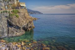 View of a beautiful small bay on the Ligurian coast, Italy. Nice clean sea with the rocks Stock Photos
