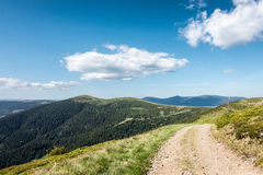 View of beautiful spring mountains with road Royalty Free Stock Images