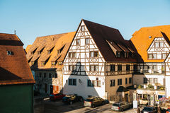 View of a beautiful street with traditional German houses in Rothenburg ob der Tauber in Germany. European city. Stock Images