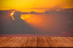 View on beautiful sunset over mediterranean sea from dark wooden Stock Photo