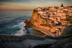Azenhas do Mar. View of beautiful town of Azenhas do Mar in Portugal at sunset light royalty free stock photos