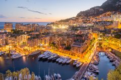 View of Monte Carlo Yacht Harbor at Sunset. View of the beautiful Town of Nice at sunset Royalty Free Stock Images