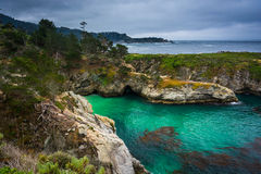 View of beautiful turquoise waters and rocky bluffs   Stock Photography