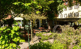 View of a beergarden. The tables in a  beergarden are still empty late in a saturday morning Royalty Free Stock Photography
