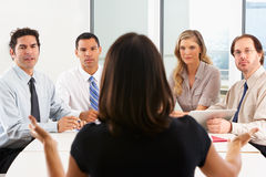 View From Behind As CEO Addresses Meeting. In Boardroom Royalty Free Stock Image