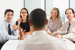 View From Behind As CEO Addresses Meeting. In Boardroom Royalty Free Stock Photography