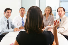 View From Behind As CEO Addresses Meeting Royalty Free Stock Photos