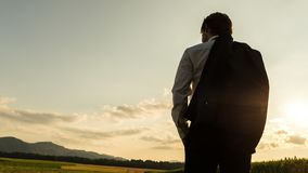 View from behind of a businessman standing with jacket over his Royalty Free Stock Photos