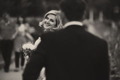 A view from behind groom's back on a marvelous blonde bride Royalty Free Stock Photo